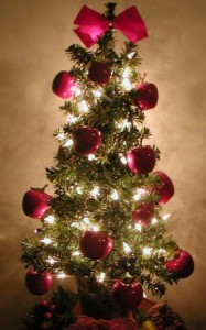 holiday decorating mini christmas tree with apples