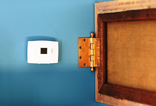 Using Household Items to Hide Eyesores in Your Apartment - Thermostat