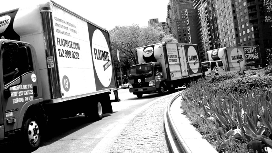 FlatRate Moving truck on street in black and white