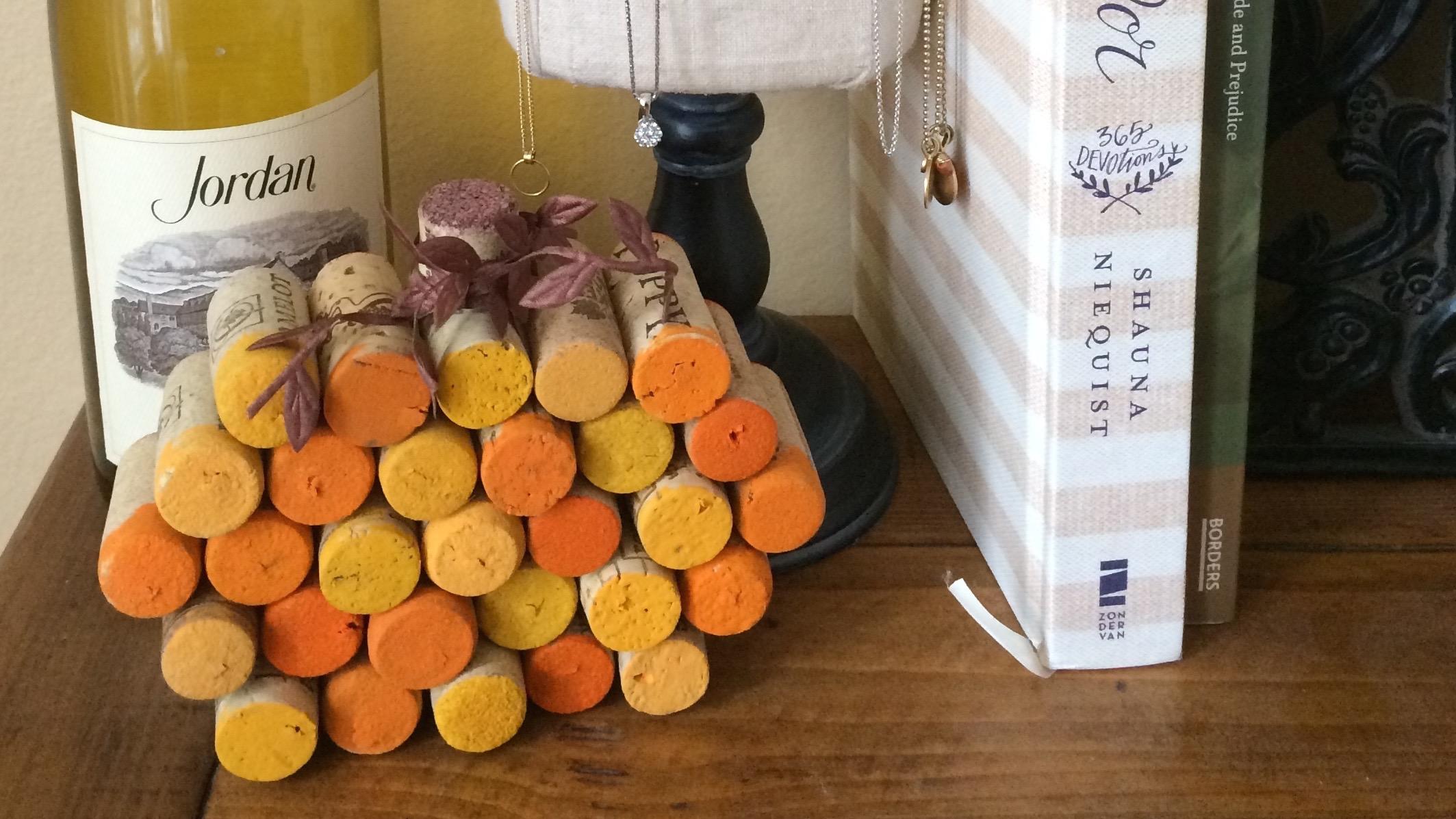 DIY Wine Cork Pumpkin on Display with Wine