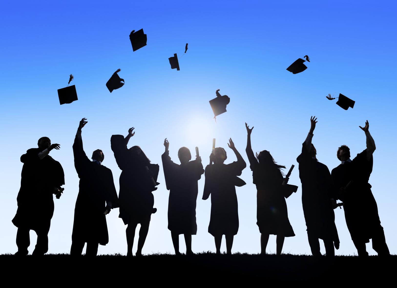 Students Celebrating Graduation Throwing Caps