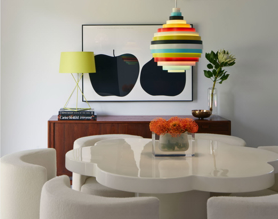 an-enchanting-white-flower-dining-table-and-rainbow-pendant-lamp-also-orange-flower-decor-for-american-modern-house