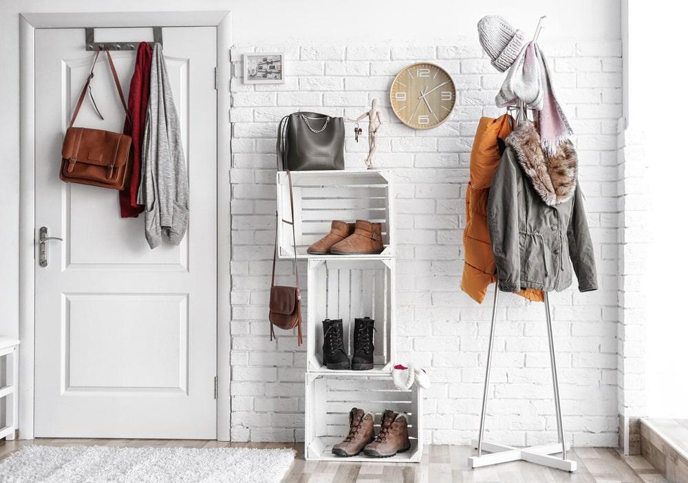 hallway storage with coat rack and storage bins
