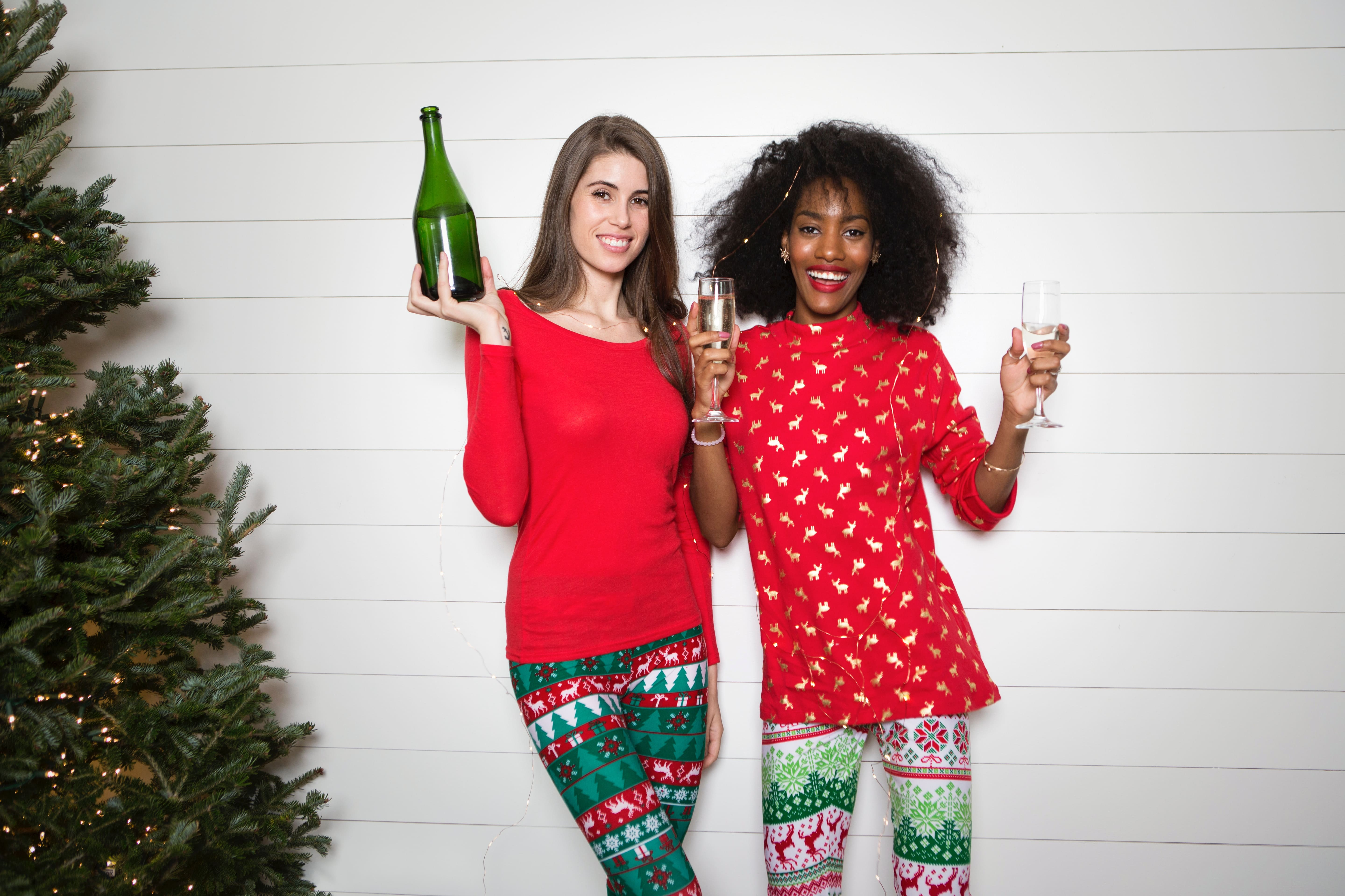 girls in holiday pajamas with wine
