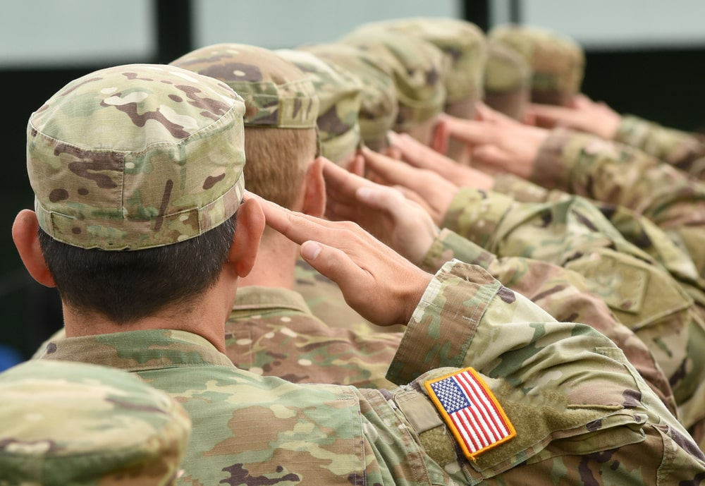 servicemen saluting