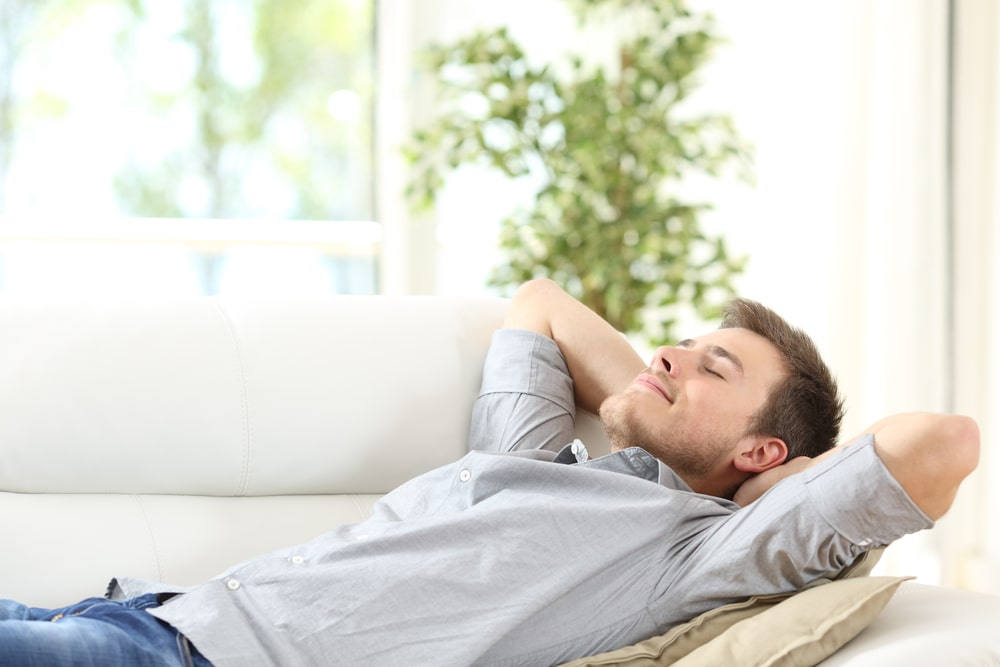 person relaxing on couch