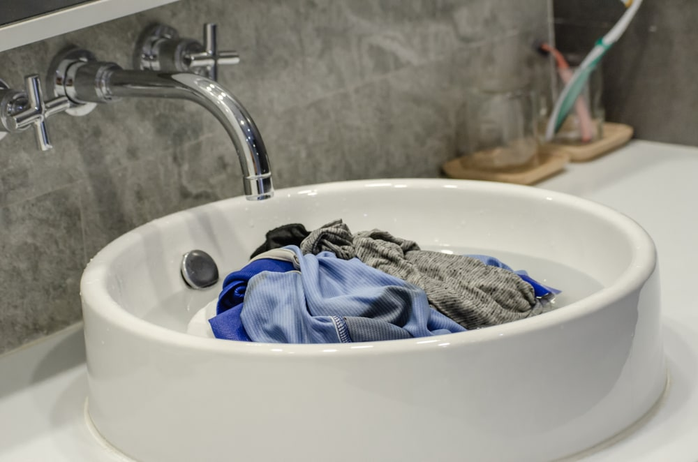 wet clothes in sink