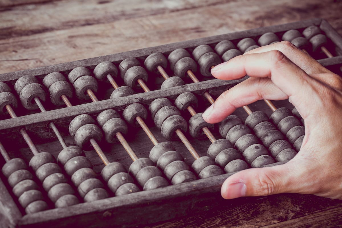 person using an abacus