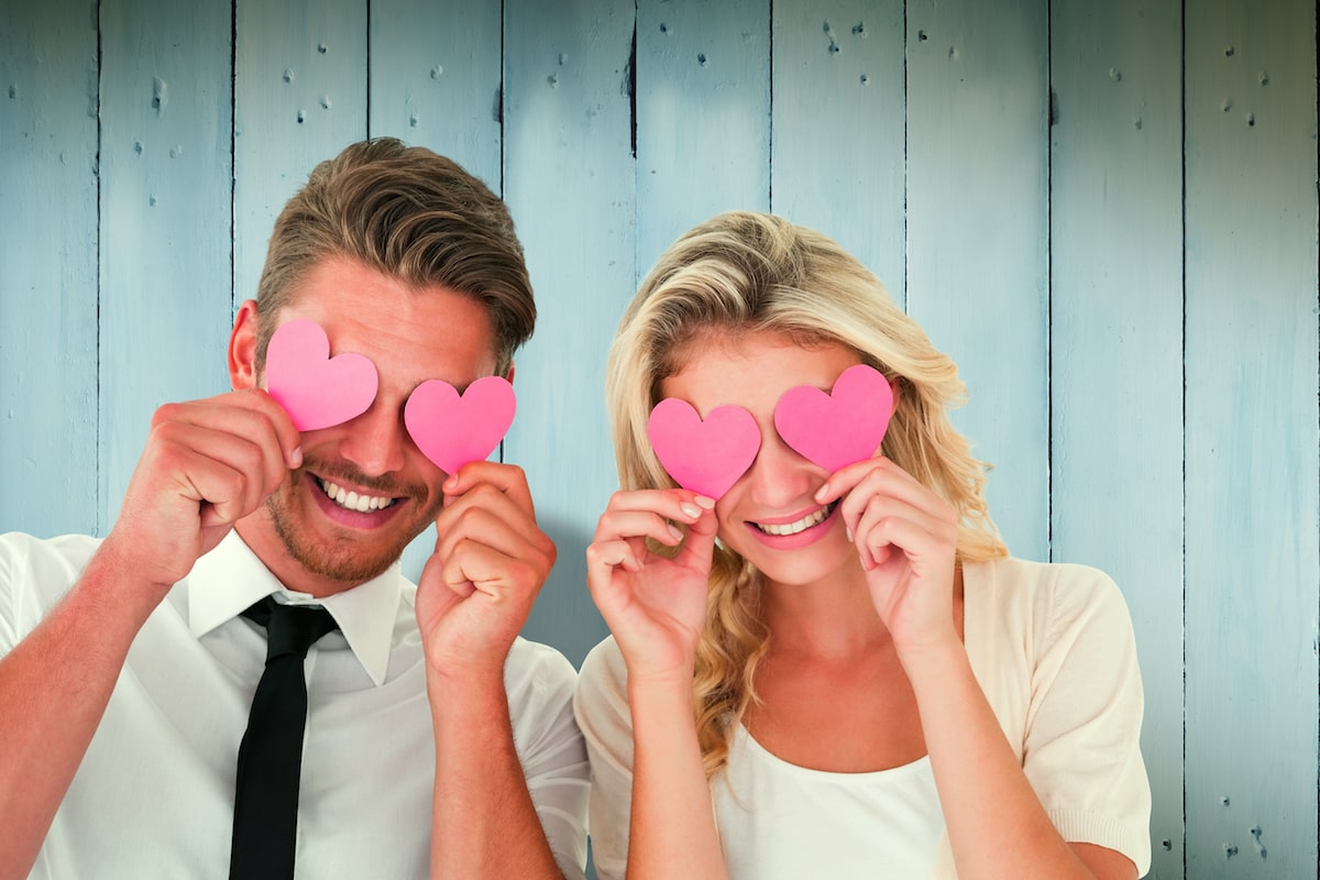 couple with pink hearts over eyes