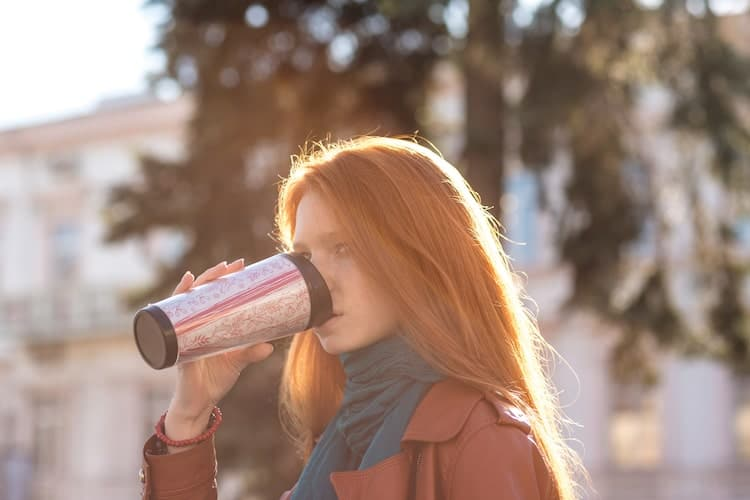 woman with tumbler