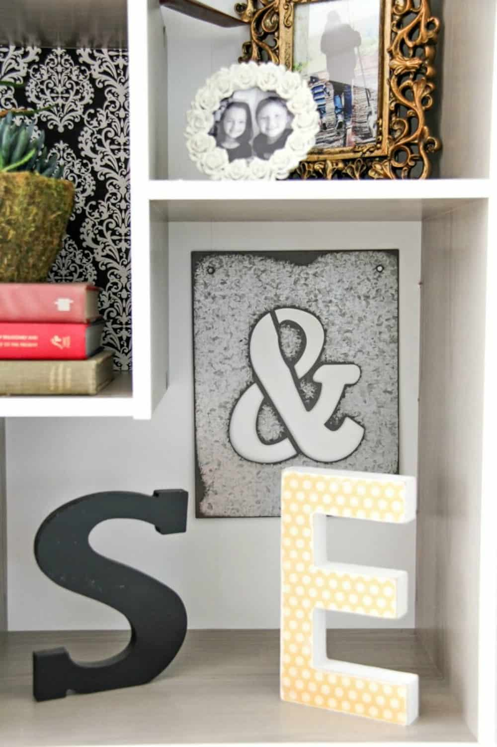 Painted wood letters decorating a book shelf