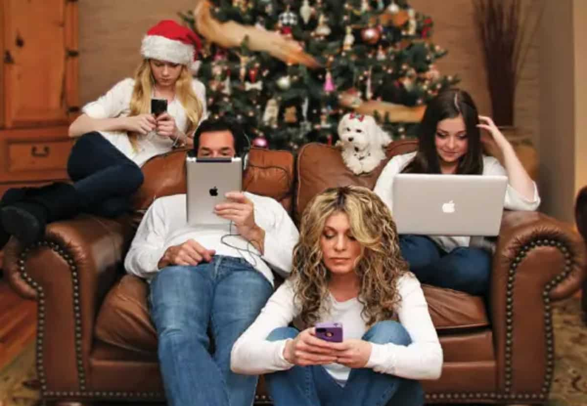 Family engrossed in screen time at Christmas