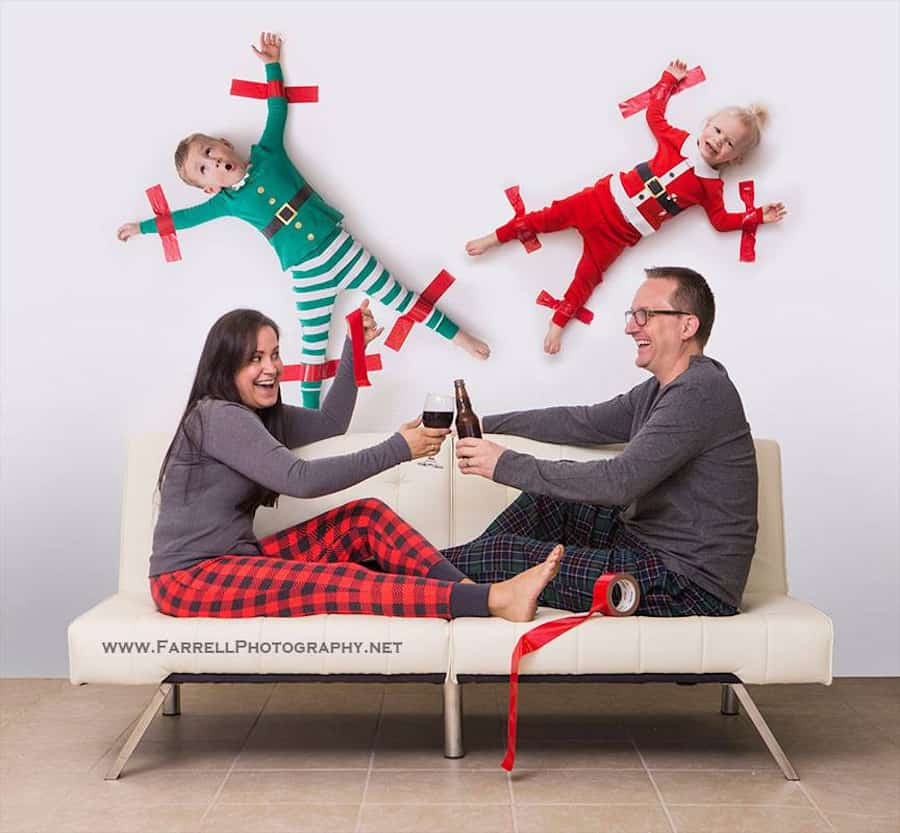Children taped to the wall while their parents look on