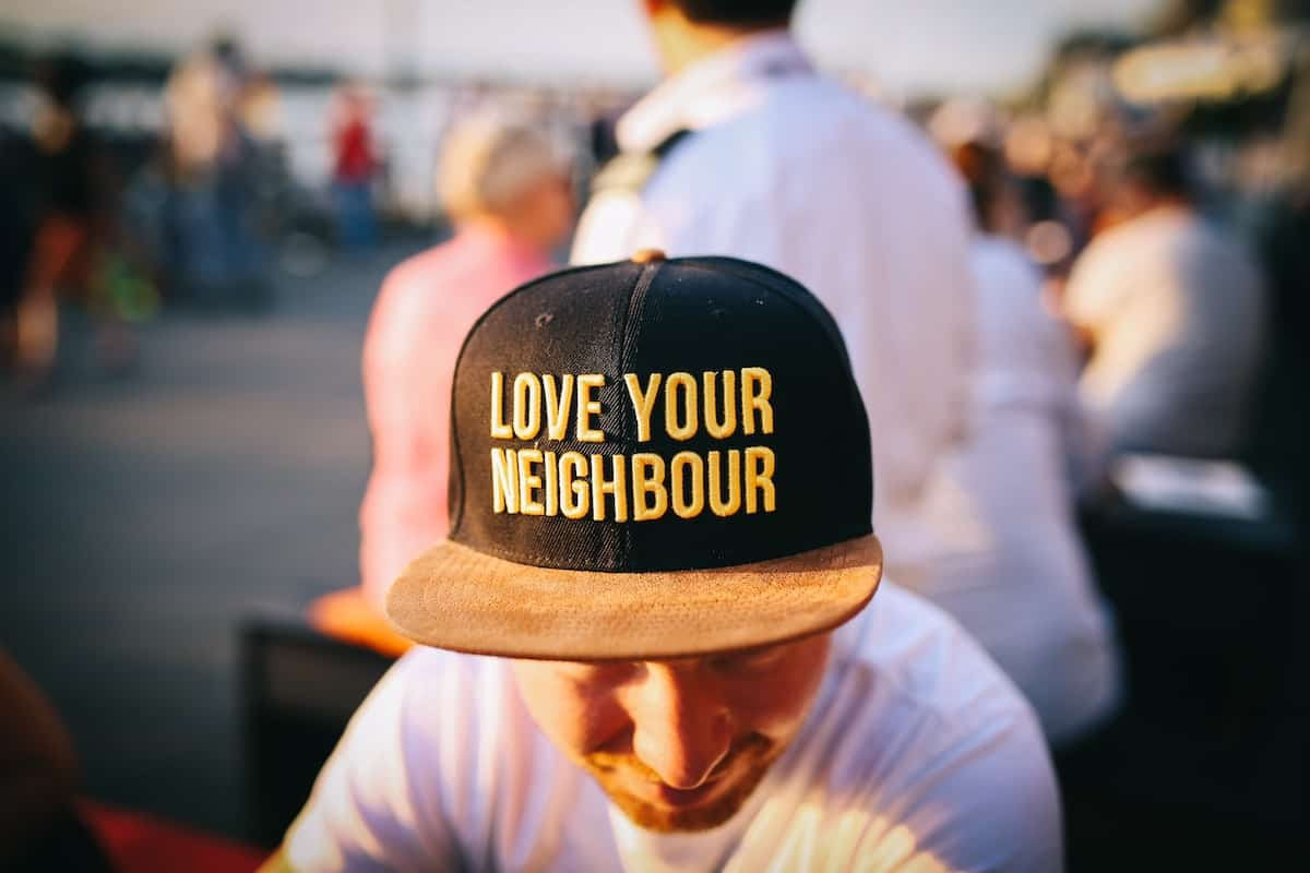 guy with love your neighbor hat