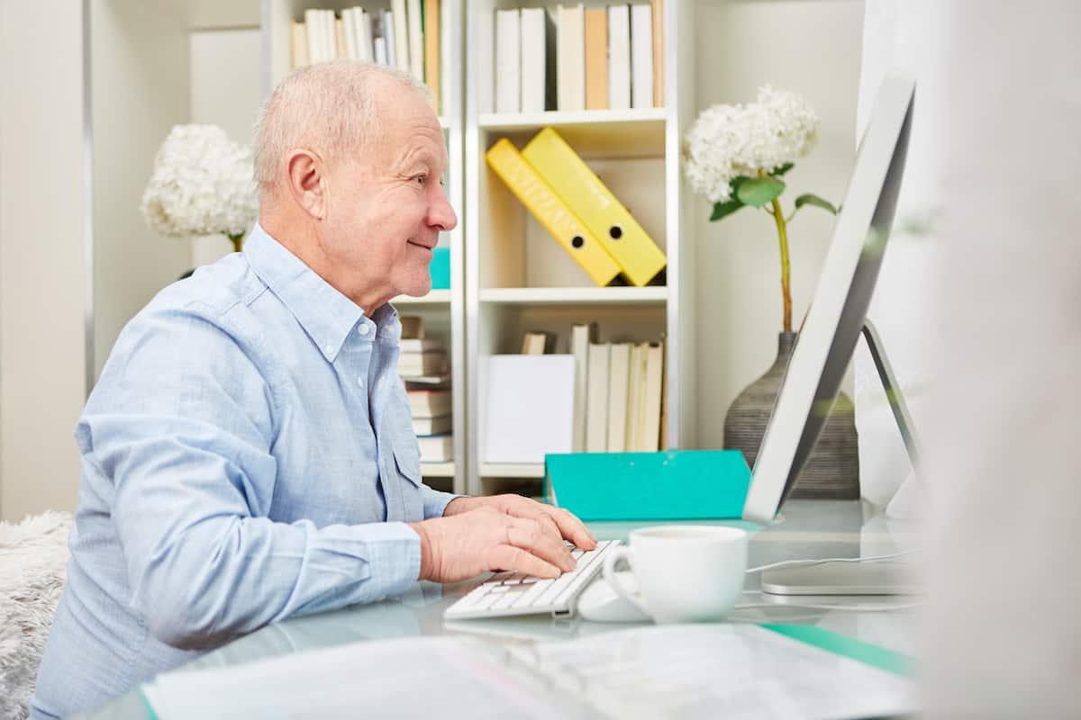 senior on computer