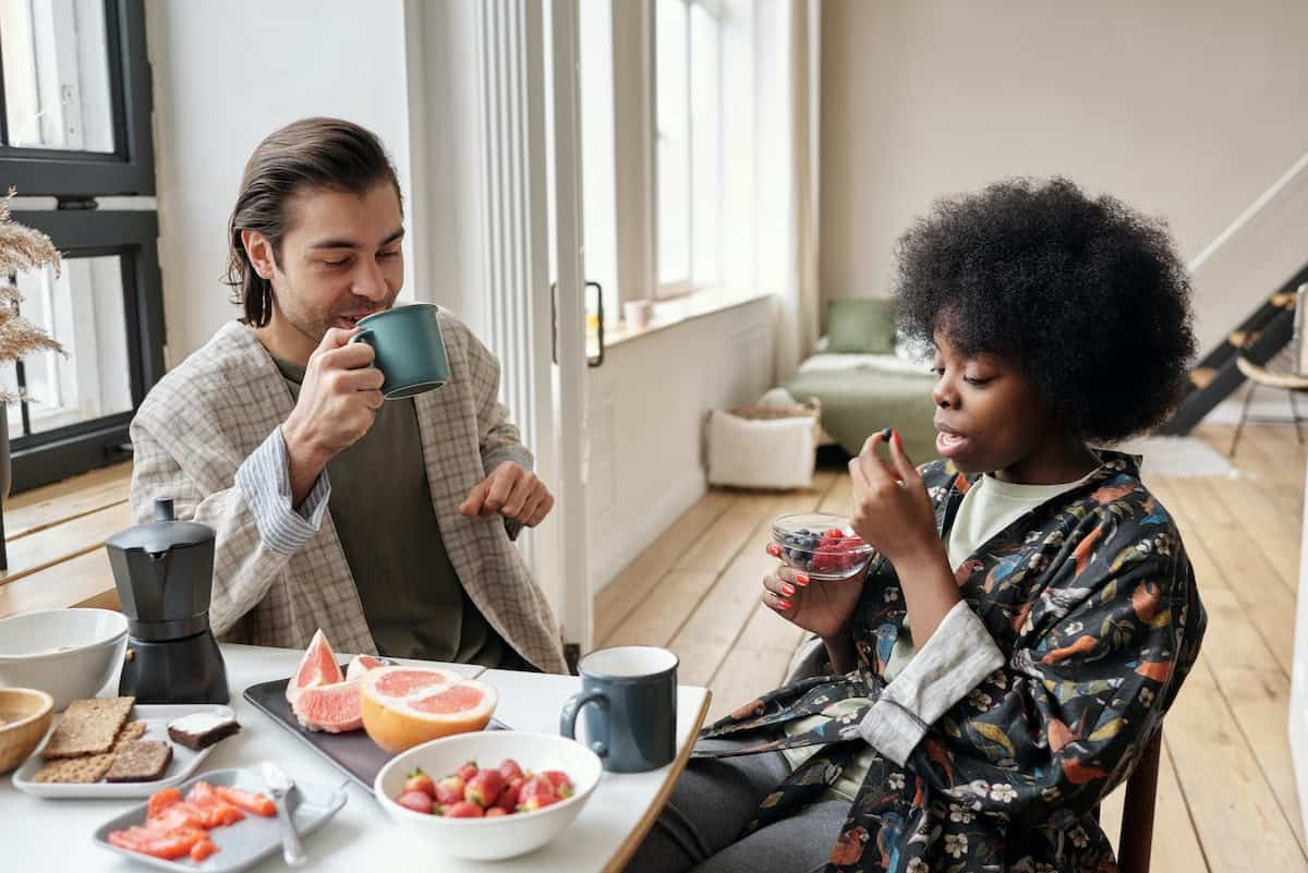 couple having breakfast talking about moving in together