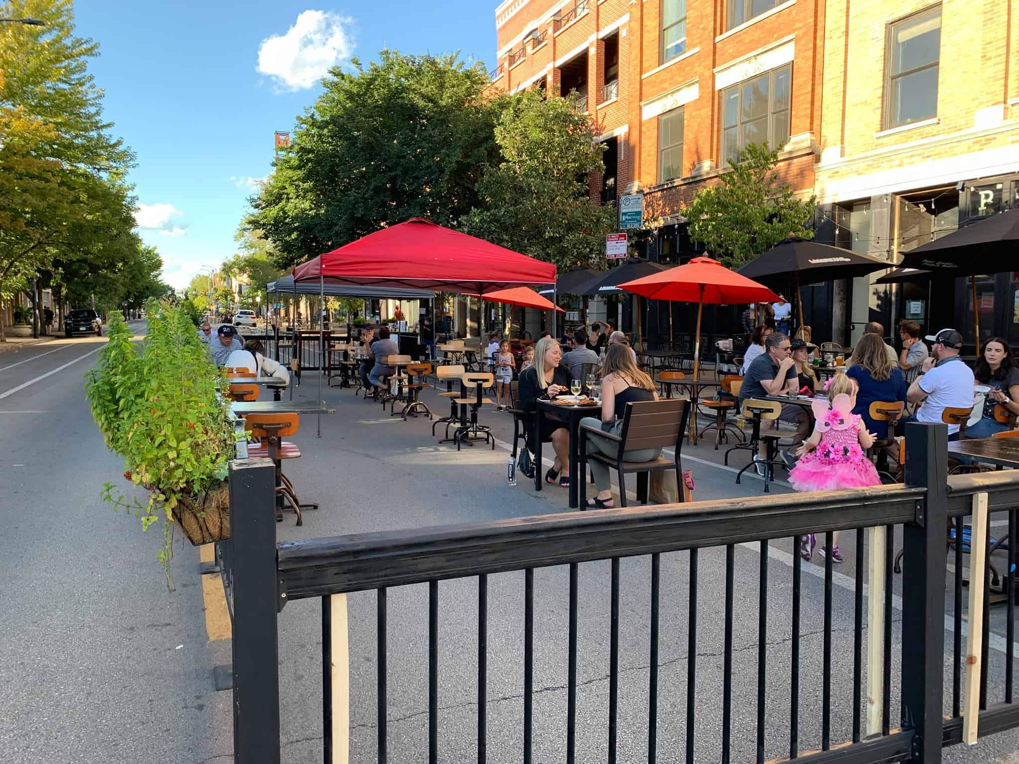 Outdoor dining on a tree lined street