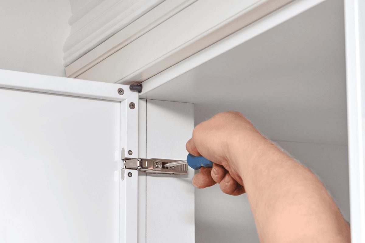 Repairing a cabinet door.