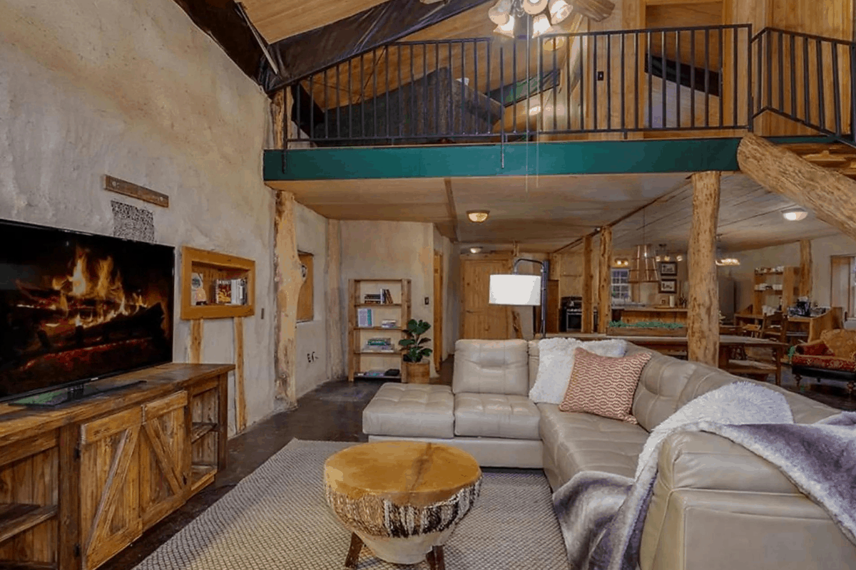 Living room in earth ship house in arkansas