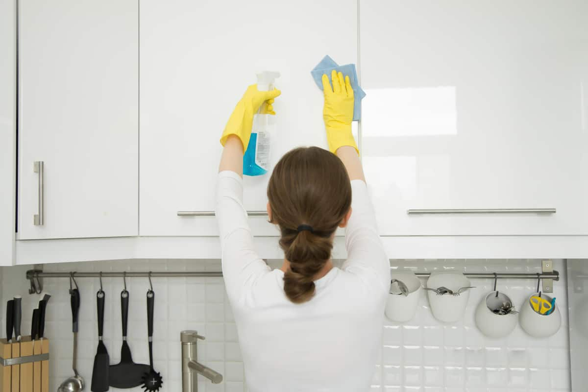Woman cleaning a cabinet!