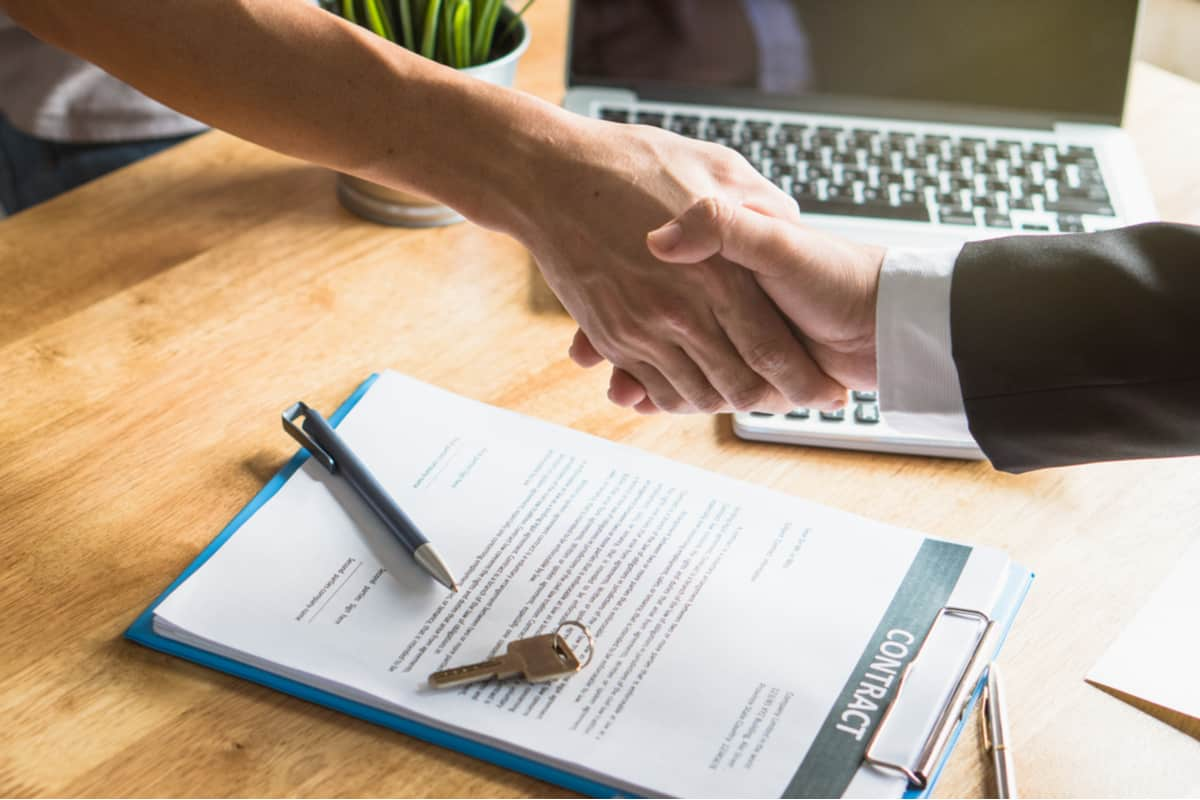 Handshaking over a contract.