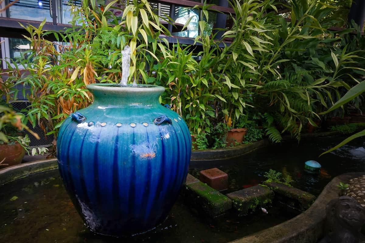 Fountain in a backyard.