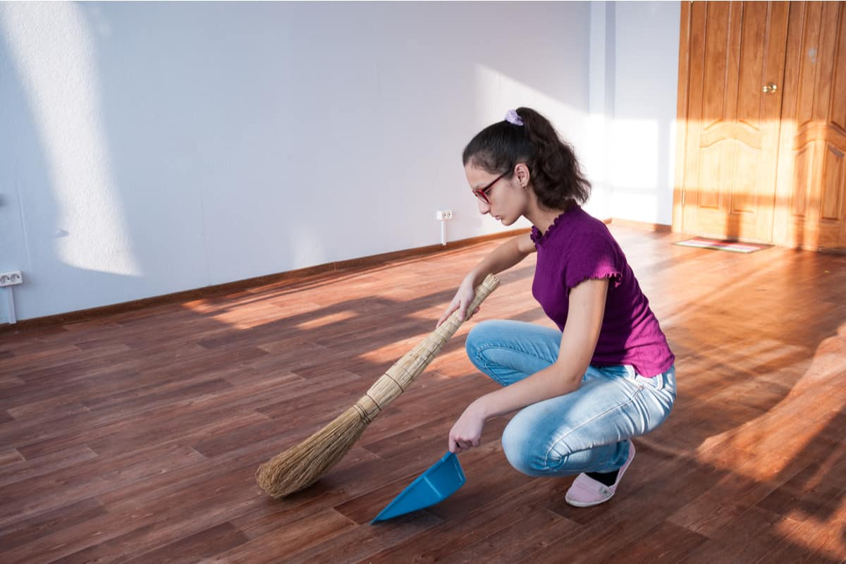 Sweeping an empty apartment.